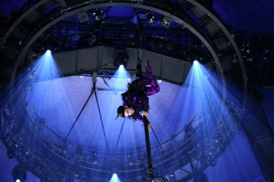 A performer descends from overhead. Photo: JOSHUA TRUJILLO, SEATTLEPI.COM / SEATTLEPI.COM