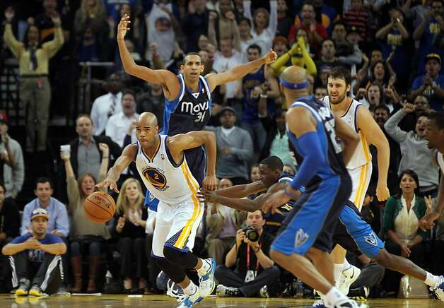 Jarrett Jack recovers the ball after Andrew Bogut (right rear) snuffed Brandan Wright (arms out) inside to seal the win. Photo: Lance Iversen, The Chronicle