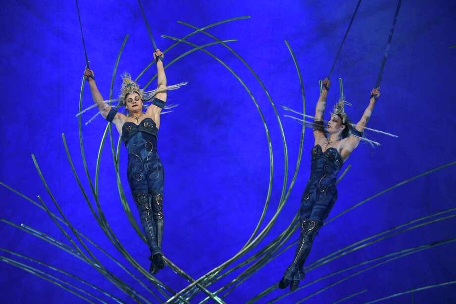 Aerial performers swing high overhead. Photo: JOSHUA TRUJILLO, SEATTLEPI.COM / SEATTLEPI.COM