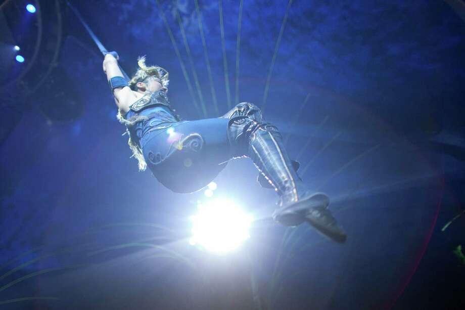 An aerial performer swings high overhead. Photo: JOSHUA TRUJILLO, SEATTLEPI.COM / SEATTLEPI.COM