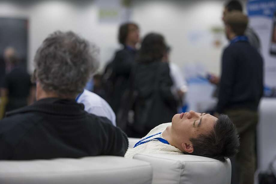 "An attendee takes a nap at the Macworld/iWorld conference at the Moscone Center West in San Francisco, California, U.S., on Thursday, Jan. 31, 2013. This year's conference, titled ""The Ultimate iFANEvent,"" brings together attendees to celebrate Apple Inc. technology and learn more about products and services for Apple users. Photo: David Paul Morris, Bloomberg"