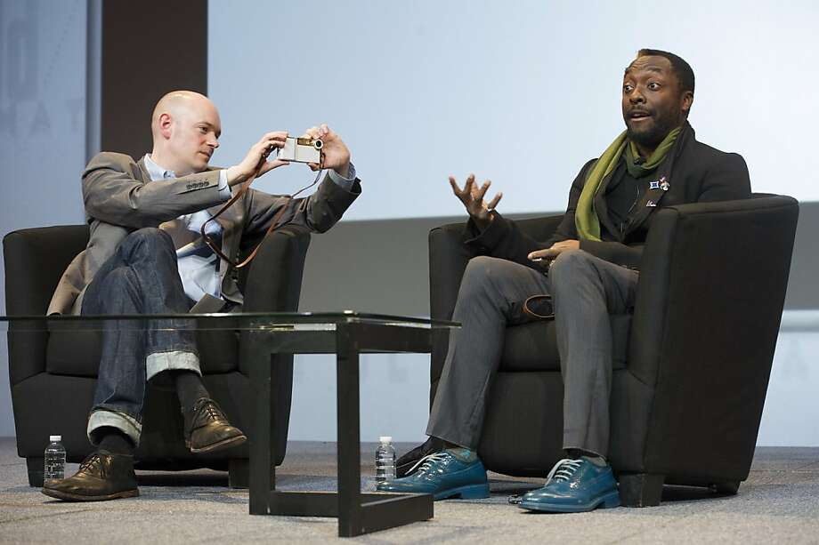 Random celebrities are making ridiculous appearances at panels.(Brian David Johnson, futurist at Intel Corp., takes a photo of recording artist Will.i.am at last year's Macworld.)  Photo: David Paul Morris, Bloomberg