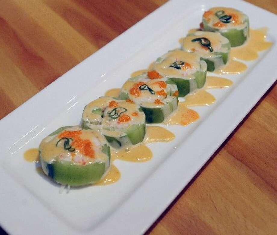 The Wrap contains cali snow crab, shrimp, and avocado wrapped in cucumber, topped with sweet sauce at Koi Japanese Sushi Bar & Lounge. Dave Ryan/cat5