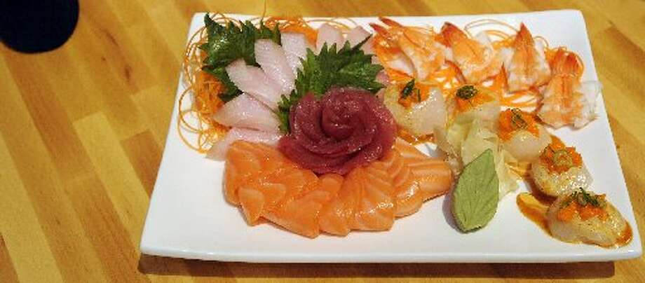 The Fresh Fish Sashimi style plate contains salmon, ahi tuna, yellowtail, scallops and boiled shrimp. Dave Ryan/cat5