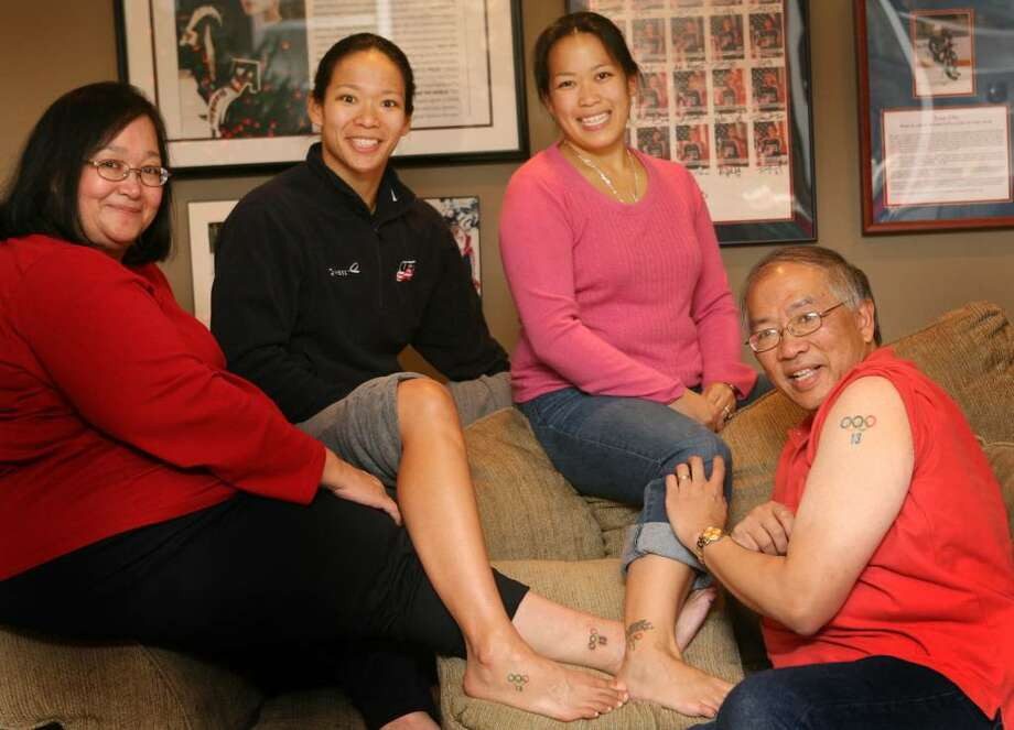 Family members of  Julie Chu, US Hockey Olympian, had the Olympic rings and Julie's number tattooed on their bodies before the 2002  Olympics. Julie's family from left to right are, mother, Miriam, Julie, sister, Christina Gargulo, and father, Wah. Photo: B.K. Angeletti / Connecticut Post