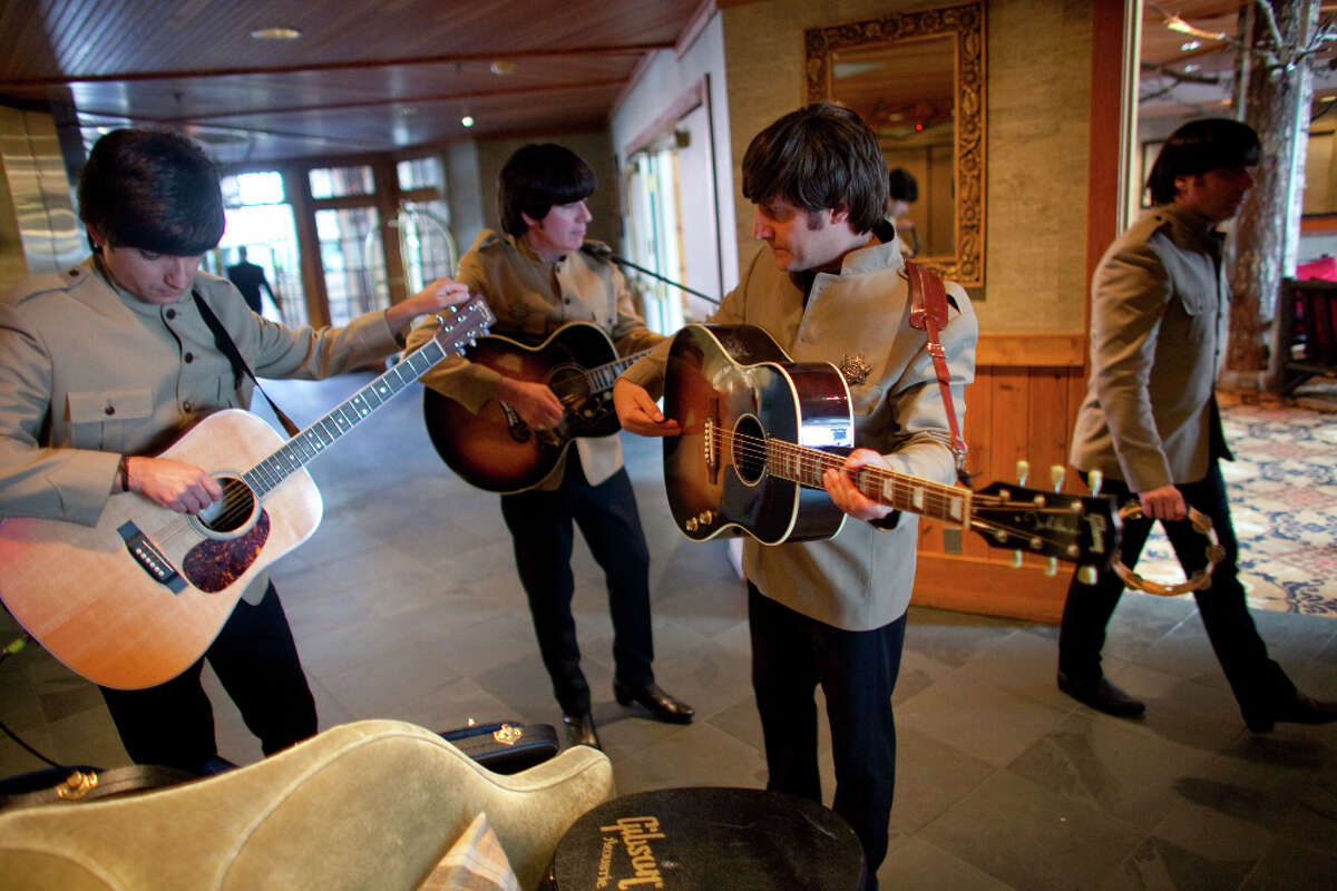 Members of Rain, a Beatles tribute band, from left, Ian Garcia, Joe Bithorn, Jim Irizarry and Doug Cox prepare to perform at Seattle's Edgewater Hotel. The band will be at Seattle's Moore Theatre for shows until Monday.