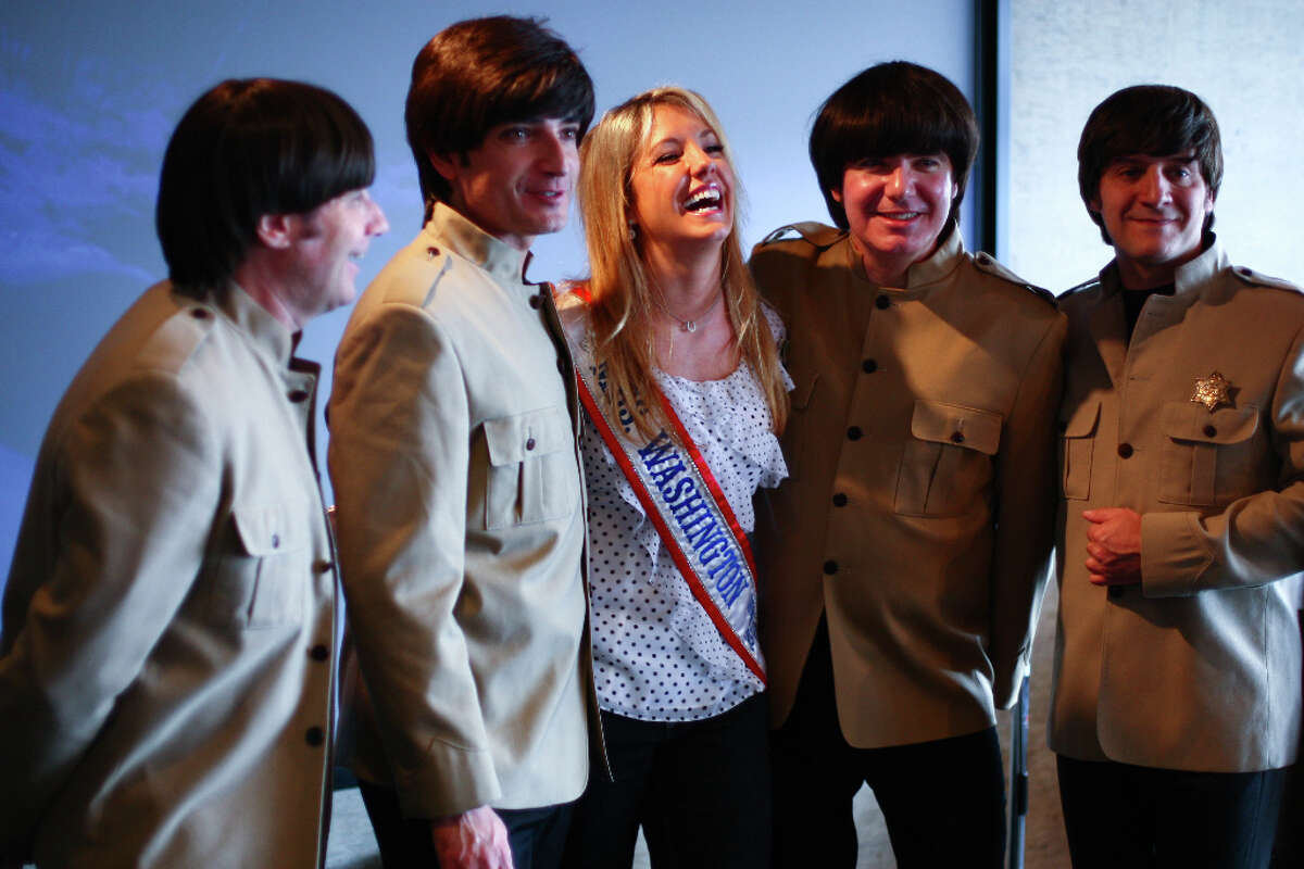 Members of Rain, a Beatles tribute band, pose with Mrs. Washington United States Kat Sturgess at Seattle's Edgewater Hotel.