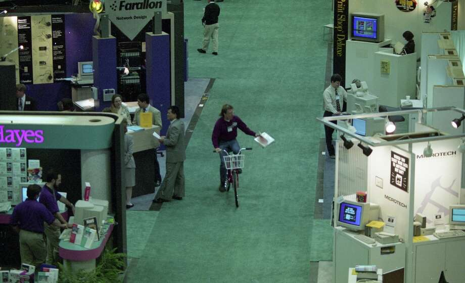 A bicyclist rides through Macworld in 1994. Photo: Mike Maloney, The Chronicle / SFC