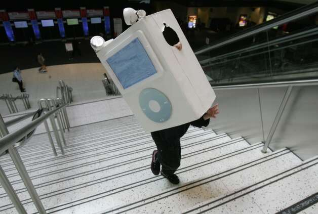 Olin Kahney, 9, carries an iPod costume up the stairs at Macworld 2006 to promote his father's book 'The Cult of iPod.' Bonus: It works as an ultra-cool Halloween and 'standing in line for the release of the next iPod' costume. Photo: Mike Kepka, SFC / The Chronicle
