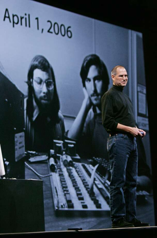 At Macworld 2006, Steve Jobs shows a photo of himself with Steve Wozniak as Apple prepares to celebrate its 30th anniversary. Photo: Paul Sakuma, AP / AP