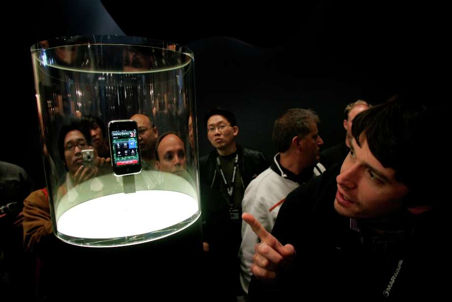 Yep, it's a phone with a screen you can touch. But not yet. The first iPhone on display at Macworld 2007. Photo: Liz Hafalia, Sfc / The Chronicle
