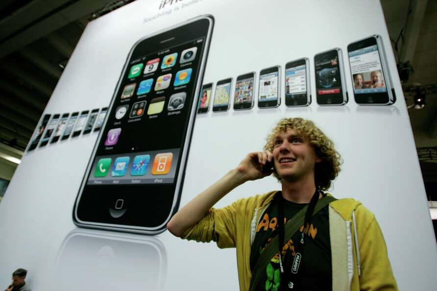 By 2008, the iPhone is in use. Wil Giesler talks on his phone at Macworld in 2008.