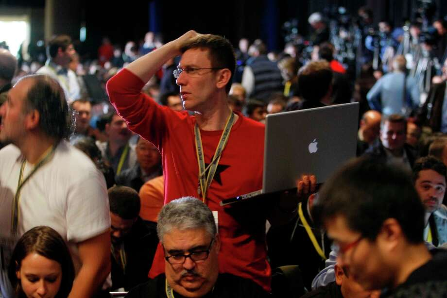 Mac fan Laurent Clause is looking ready to get his mind blown at the Macworld keynote address in 2009. Photo: Mike Kepka, The Chronicle / SFC