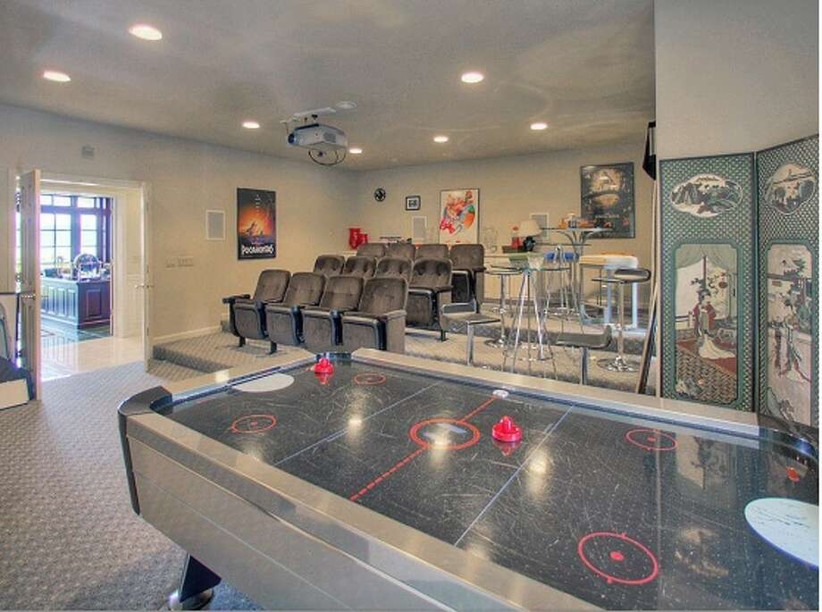 This contemporary man cave is located up in Seattle and part of a 5 bed, 6.5 bath 9,163-square-foot home.  A short sale asking $2.1 million.