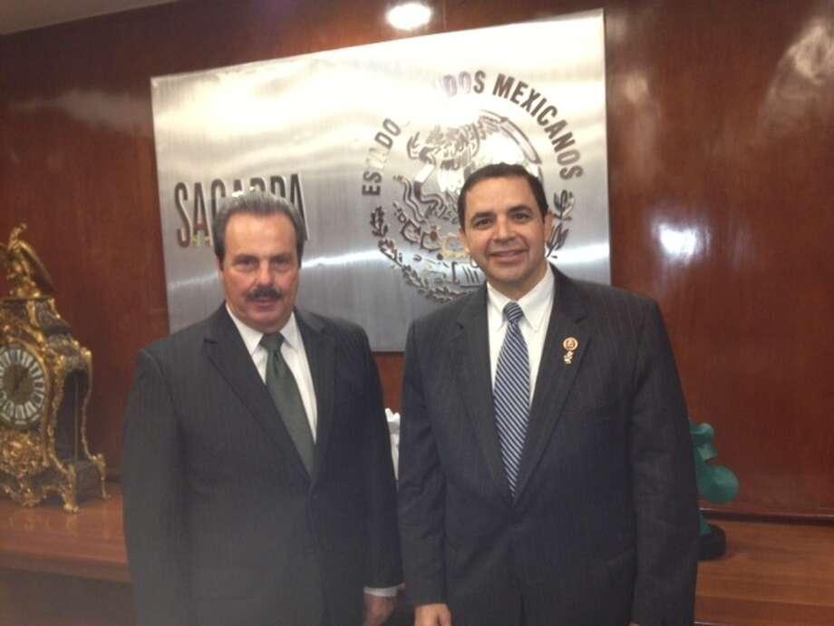 Congressman Henry Cuellar, right, with Mexico's Secretary of Agriculture Enrique Martinez y Martinez.