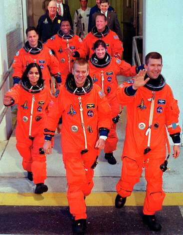 "(FILES) This 16 January, 2003 file photo shows the crew of US space shuttle Columbia (first row: L-R) US Pilot William McCool, Commander US Rick Husband, (second row, L-R) US Kalpana Chawla, US Laurel Clark, (third row, L-R) Israeli Ilan Ramon, US Michael Anderson and US David Brown as they leave the crew quarters at Kennedy Space Center, Florida.  The Columbia Accident Investigation Board's (CAIB) released the official inquiry into the Columbia space shuttle accident 26 August, 2003 saying that NASA managers were ""as much a cause"" of the tragedy as technical faults in the 01 February, 2003 space shuttle's explosion.       AFP PHOTO/ BRUCE WEAVER  (Photo credit should read BRUCE WEAVER/AFP/Getty Images) Photo: BRUCE WEAVER, Stringer / AFP"