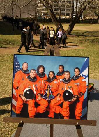 Family members of the STS-107 crew pass a portrait of the crew at the Johnson Space Center as they depart a memorial service mourning the loss of the seven astronauts aboard the Space Shuttle Columbia, Tuesday afternoon, February 4, 2002.  (Smiley N. Pool/Chronicle) Photo: SMILEY N. POOL, STAFF / HOUSTON CHRONICLE