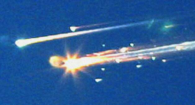 In this Feb. 1, 2003 file photo, debris from the space shuttle Columbia streaks across the sky over Tyler, Texas.  (AP Photo/Dr. Scott Lieberman, File) Photo: Dr. Scott Lieberman, STR / Beaumont