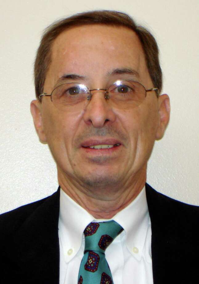 This undated handout photo provided by the Kaufman County Sheriff's office shows assistant district attorney Mark Hasse, 57, who was shot and killed Thursday morning, Jan. 31, 2013, in Kaufman, Texas. Authorities said they were searching for two suspects that attacked him as he exited his vehicle in the parking lot behind the Kaufman County Courthouse annex where he worked. (AP Photo/Kaufman County Sheriff) Photo: HOPD / Kaufman County Sheriff