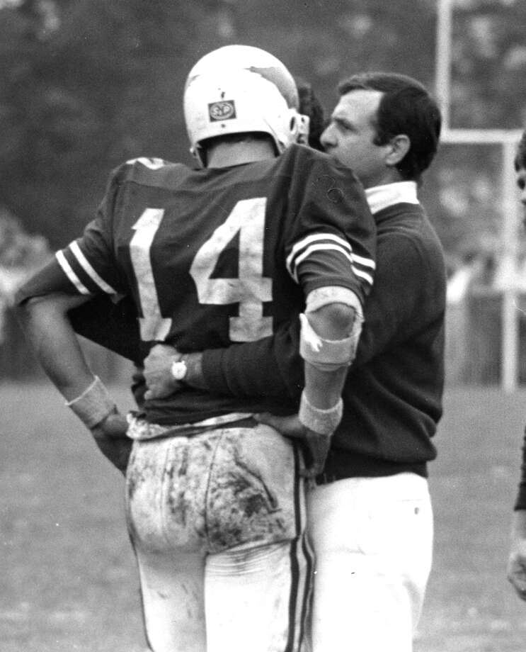 Former Greenwich High School football coach Mike Ornato talks to quarterback Steve Young during a game against Darien High School in November 1979. Photo: Greenwich Time