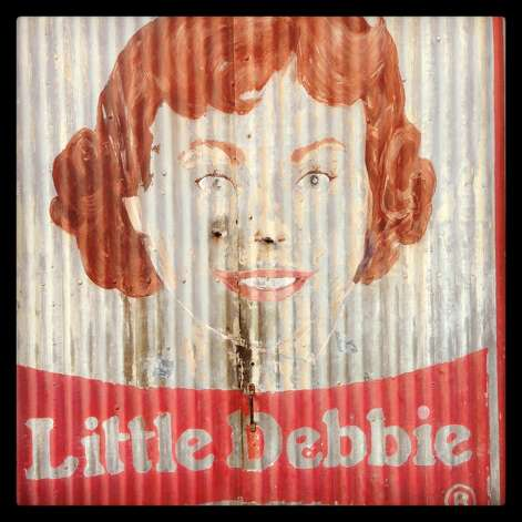 A fading Little Debbie watches over New Orleans' Warehouse District.