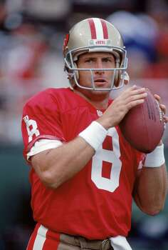 Quarterback Steve Young of the San Francisco 49ers warms up during a preseason game against the Seattle Seahawks at Candlestick Park on August 26, 1994 in Photo: George Rose, ST / 1994 Getty Images