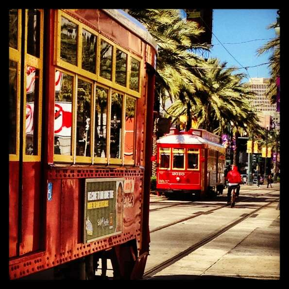 The streetcars and palm-lined median of Canal Street in the French Quarter.