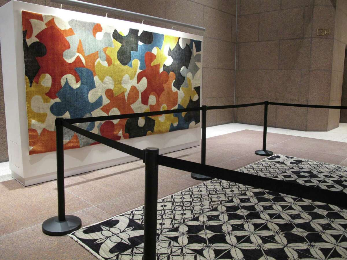 The Arzu Master's Collection, on display at the Bank of America building through Feb. 15, features rugs designed by international architects, including Frank Gehry, Margaret McCurry, Zaha Hadid and Micheal Graves and crafted by Afghan women.