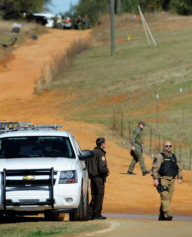 Law officers at the Dale County hostage scene in Midland City, Ala. on Thursday, Jan. 31, 2013. A gunman holed up in a bunker with a 6-year-old hostage has kept law officers at bay since the standoff began when he killed a school bus driver and dragged the boy away, authorities said. Photo: Montgomery Advertiser, Mickey Welsh