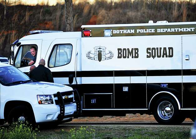 The Dothan Police Department Bomb Squad van rolls into a checkpoint in Pinckard, Ala., below the home where Tuesday's school bus shooting suspect is barricaded in a bunker with a five-year-old boy as a hostage Thursday, Jan. 31, 2013. Speaking into a 4-inch-wide ventilation pipe, hostage negotiators tried Thursday to talk a man into releasing a kindergartener and ending a standoff in an underground bunker that stretched into its third day. Photo: The Dothan Eagle, Jay Hare