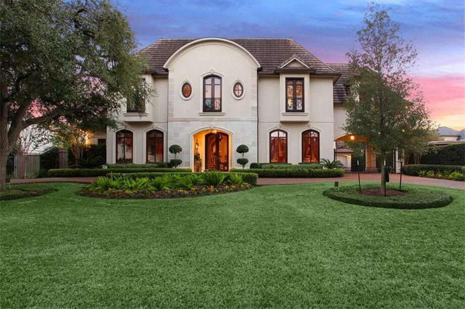 This two-story French chateau-style home is defines balance and beauty, and showcases attention to detail, and exceptional millwork and finishes.Read more about the home. Photo: Martha Turner Properties