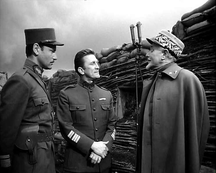 Richard Anderson (left), Kirk Douglas and George Macready in