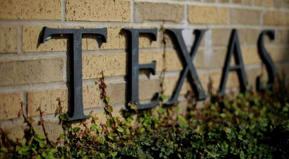 ADVANCE FOR SUNDAY FEB. 3 AND THEREAFTER - Ivy grows near the lettering of a entrance to the University of Texas, Thursday, Nov. 29, 2012, in Austin, Texas.   If colleges were automobiles, the University of Texas at Austin would be a Cadillac: a famous brand, a powerful engine of research and teaching, a pleasingly sleek appearance. Even the price is comparable to the luxury car's basic model: In-state tuition runs about $40,000 for a four-year degree. (AP Photo/Eric Gay) Photo: Eric Gay, STF / AP
