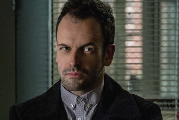 "Jonny Lee Miller plays the famously anti-social Sherlock Holmes in ""Elementary."" Photo: CBS / ©2012 CBS Broadcasting Inc. All Rights Reserved."