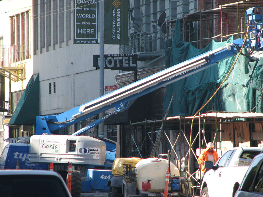 942 Mission and Jessie, early Jan. 2013; Protective tarps are placed on front of building at start of the project