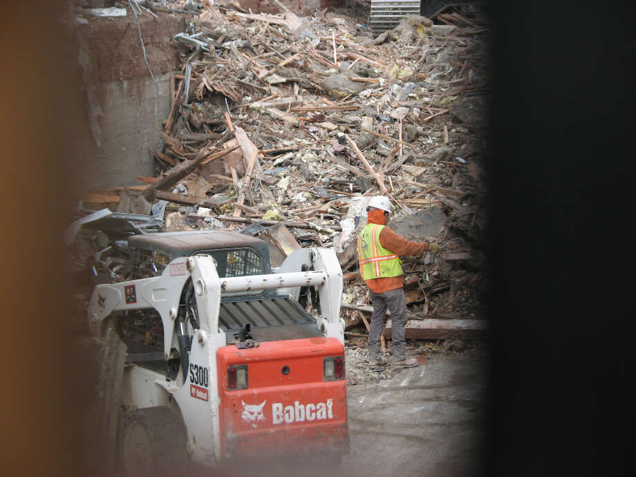 942 Mission and Jessie, mid-Jan. 2013; Worker faces pile of rubble  below street level