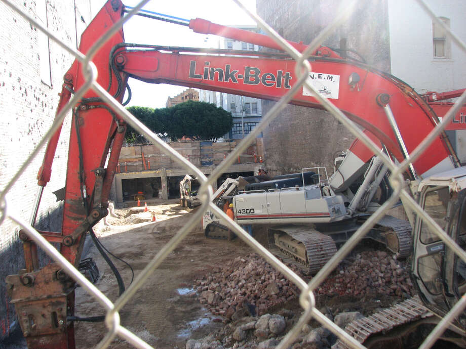 942 Mission and Jessie, third week Jan. 2013; Excavator is a tight fit on the narrow site
