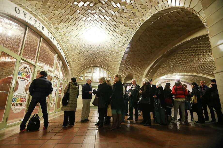 NEW YORK, NY - FEBRUARY 01:  People wait on line to enter the famed Oyster Bar in Grand Central Terminal before during centennial celebrations on the day the famed Manhattan transit hub turns 100 years old on February 1, 2013 in New York City. The terminal opened in 1913 and is the world's largest terminal covering 49 acres with 33 miles of track. Each day 700,000 people pass through the terminal where Metro-Noth Railroad operates 700 trains per day. Photo: Mario Tama, Getty Images / 2013 Getty Images