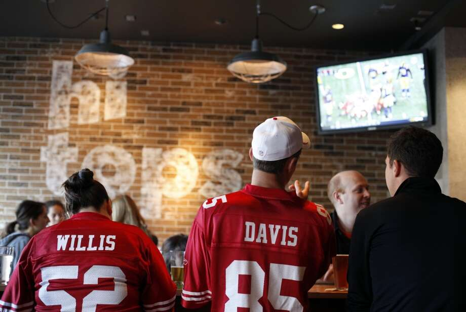 Hi Tops. The months-old gay sports bar is already home to the lasting cute image of these NFL playoffs, so it must be a good place to watch the game.