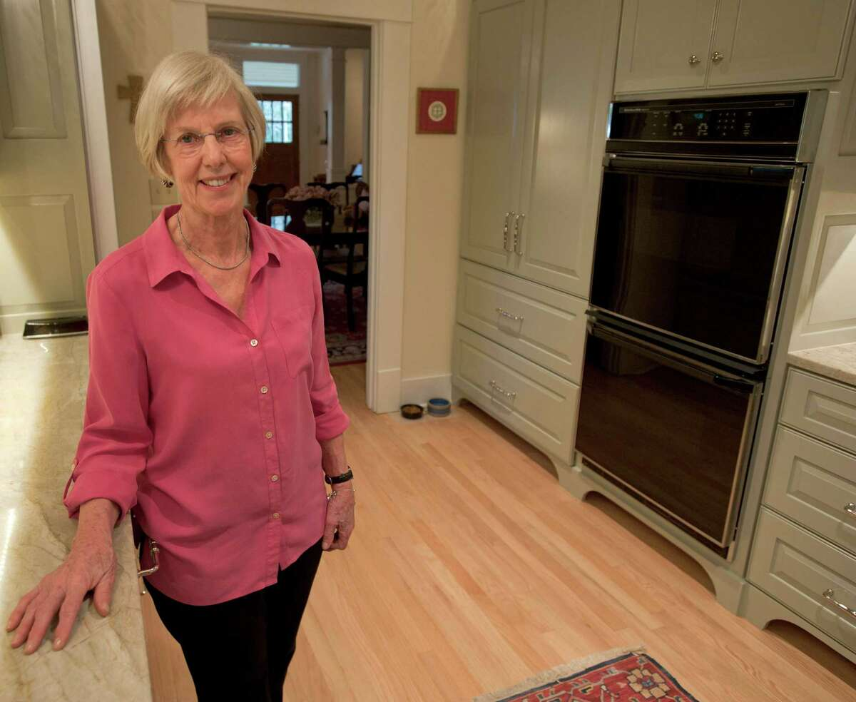 Helen Schnelzer poses in her recently-remodeled kitchen, Monday, Jan. 28, 2013, at her home in San Antonio.