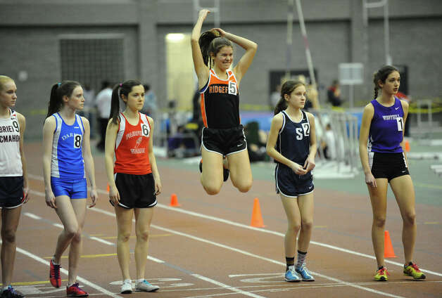 Ridgefield's Laura Hergenrother does a traditional pre-race leap before competing in the 3000 meter running event during FCIAC Indoor Track and Field Championships in New Haven, Conn. on Thursday January 18, 2013. Photo: Christian Abraham / Connecticut Post