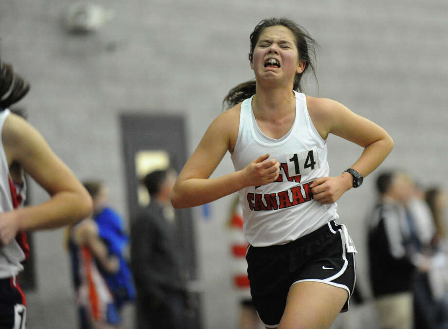 New Canaan's Sarah Endres reacts as she competes in the 3000 meter running event during FCIAC Indoor Track and Field Championships in New Haven, Conn. on Thursday January 18, 2013. Photo: Christian Abraham / Connecticut Post