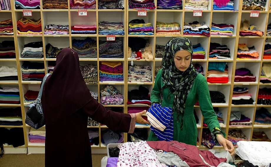 Mahum Tahir (right), 14, picks out colorful scarves with her mom, Fouzia Tahir, at Islamic fashion store Al-Anwar in Anaheim. Photo: Gina Ferazzi, McClatchy-Tribune News Service