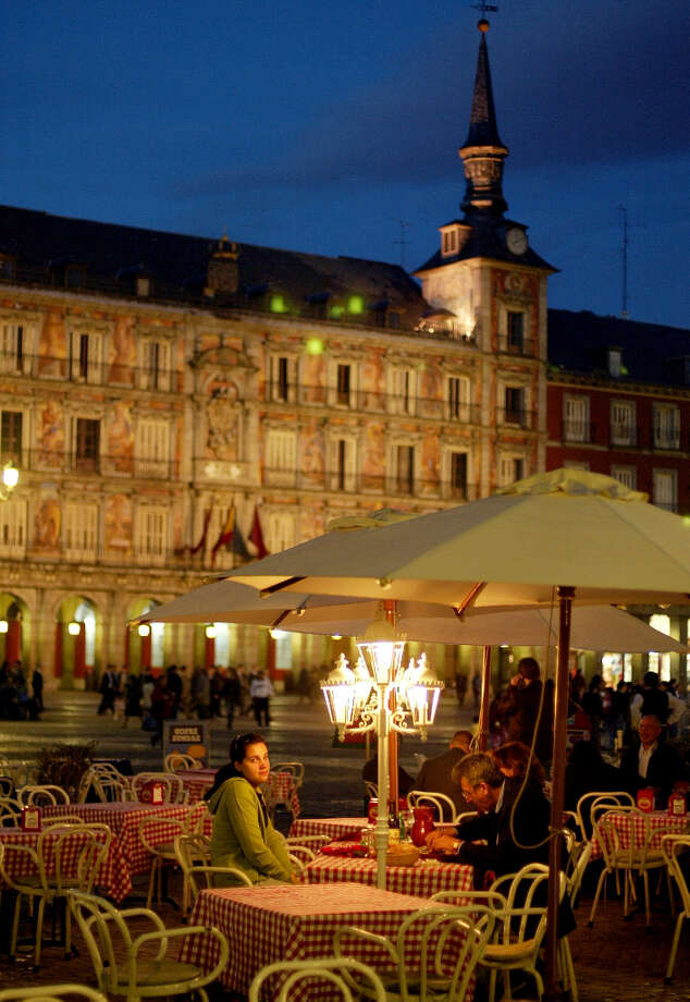 6. MADRID - Plaza Mayor, surrounded by markets, bars, cafes and parks, is at the heart of Madrileños' Sunday stroll. Photo: PEDRO ARMESTRE, AFP/Getty Images / AFP