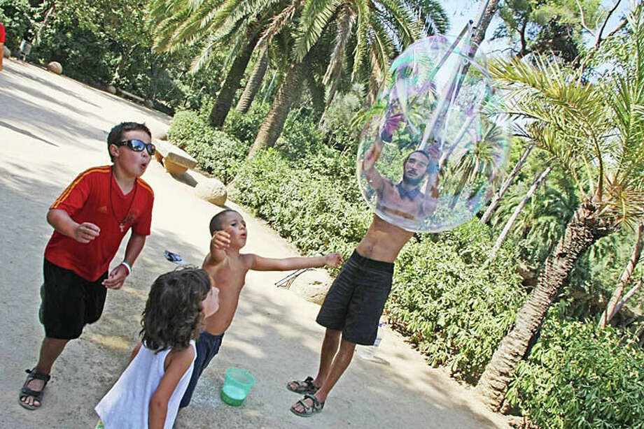 3. BARCELONA - Gaudi park in Barcelona is alive with performers and musicians in the summer.