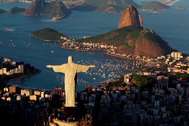 1. RIO DE JANEIRO - The statue of Christ the Redeemer is seen with the Sugar Loaf mountain at back in Rio de Janeiro, Brazil. Photo: Felipe Dana, Associated Press / AP