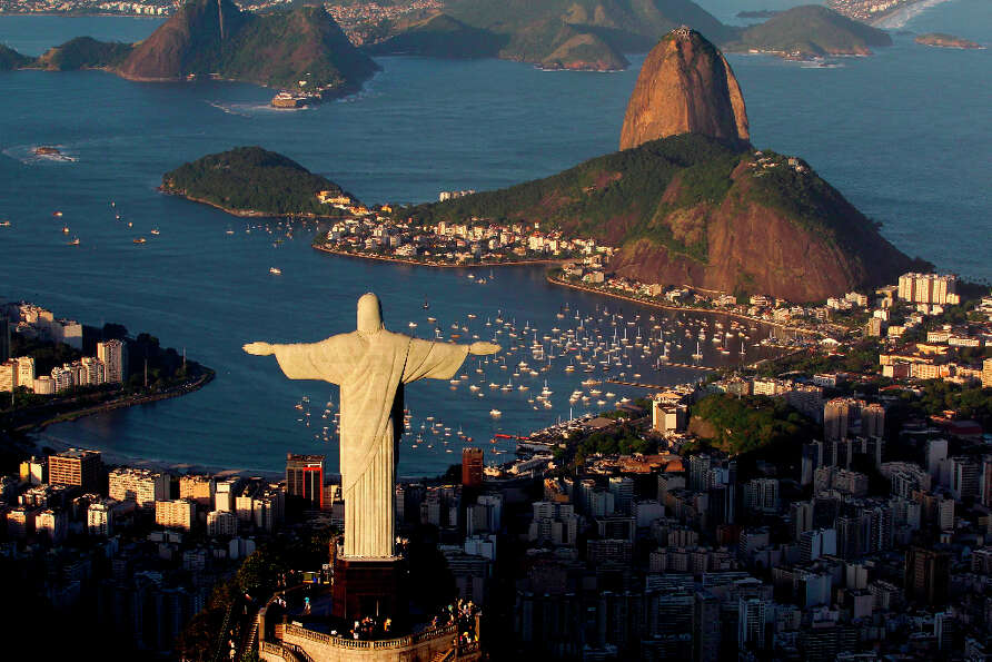 1. RIO DE JANEIRO - The statue of Christ the Redeemer is seen with the Sugar Loaf mountain at