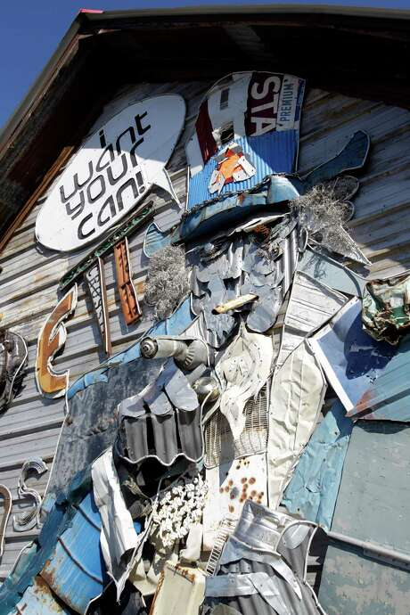 Whimsical office building of TJ Burdett & Sons Recycling, 570 Interstate 45 Frontage Road, built by Dan Phillips of Phoenix Commotion from recycled materials shown Wednesday, Jan. 16, 2013, in Huntsville. ( Melissa Phillip / Houston Chronicle ) Photo: Melissa Phillip, Staff / © 2013 Houston Chronicle
