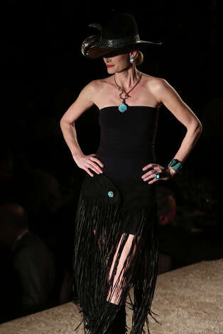 Sherri Lubianski poses on the runway in an outfit from Julian Gold during the Cowgirls Live Forever Fashion Show at the Pearl Stable in San Antonio on Thursday, Jan. 24, 2013. Photo: Lisa Krantz, San Antonio Express-News / © 2012 San Antonio Express-News