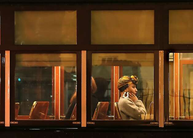 A passenger aboard streetcar along the Canal Street line near the French Quarter of New Orleans, La. on Thursday Feb. 2, 2013. Photo: Michael Macor, The Chronicle